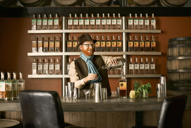 Seth at the bar mixing a Beetdown with his Sno Gin.