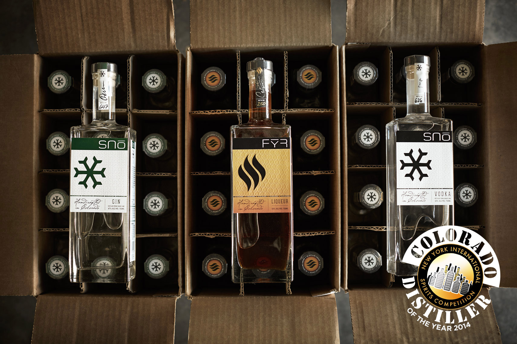 Awards from left: Breckenridge Double Gold, Silver and Gold and right: New York International Spirit Competition, Colorado Distiller of the Year 2014