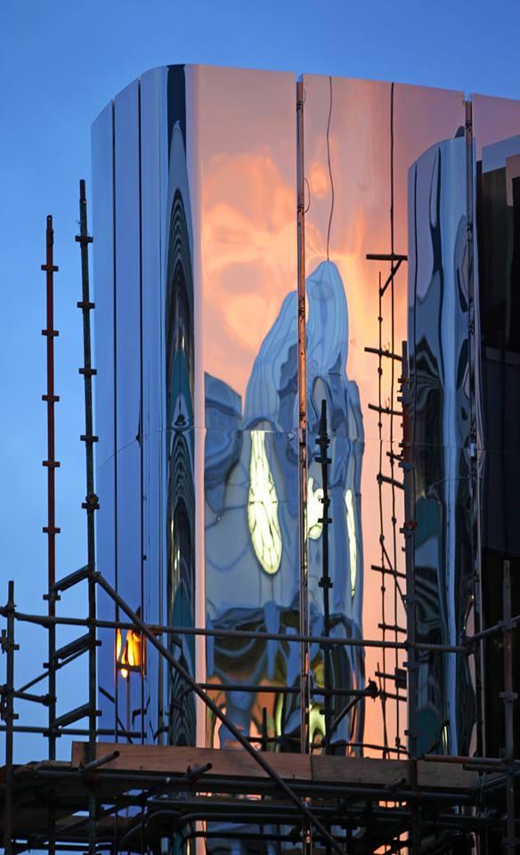 Sun rises over the Len Lye Centre Stainless Steel Panels -  Photo by Glenn Jeffrey for Govett Brewster Art Gallery