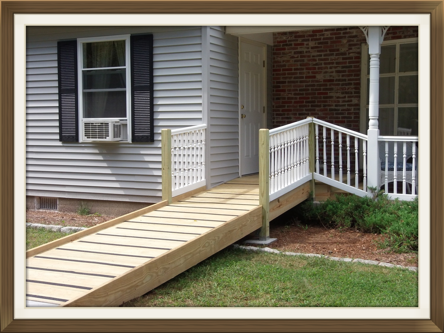 """""""With a disabled person in our home, we needed easy access to the outdoors. It was not possible without the ramp. The crew created a new doorway, a platform with a step-down to our  front porch  and a combination weathered wood and concrete ramp which conforms to residential code and allows easy access to the outdoors and to the driveway for transportation away from home.  This is the third project the company has done for us and each one has been done with care and consideration for our family needs.""""      Ginger N. -Peterborough, NH"""