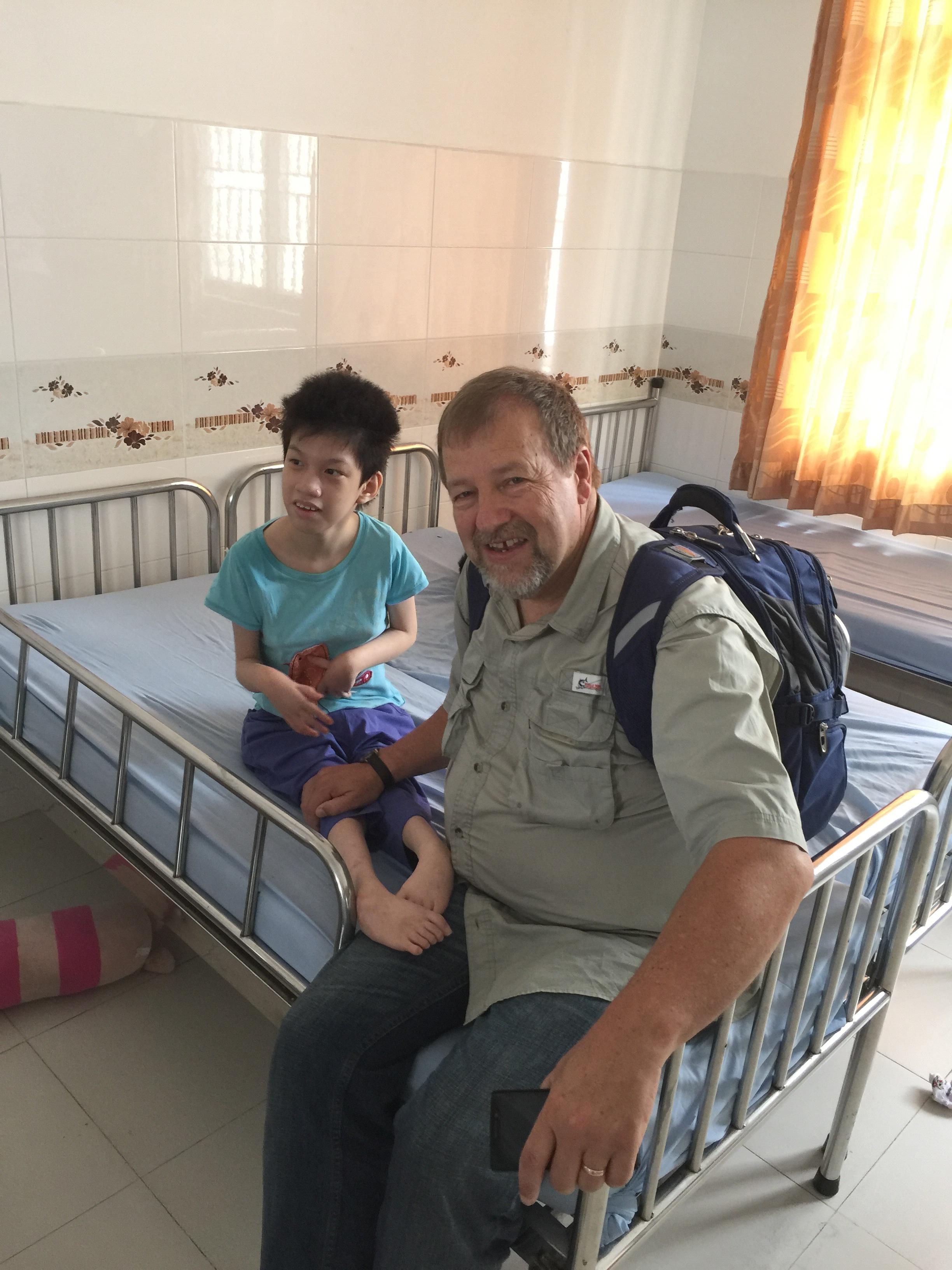 Pastor Jerry ministering to sick children in Vietnam.