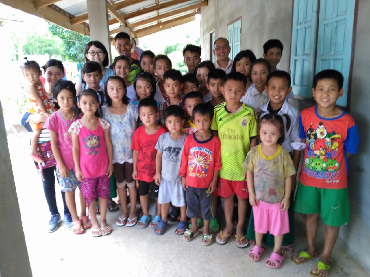 Poor village children gather at the local church to receive school Backpacks and Bible gifts in SW Thailand near the Myanmar border.