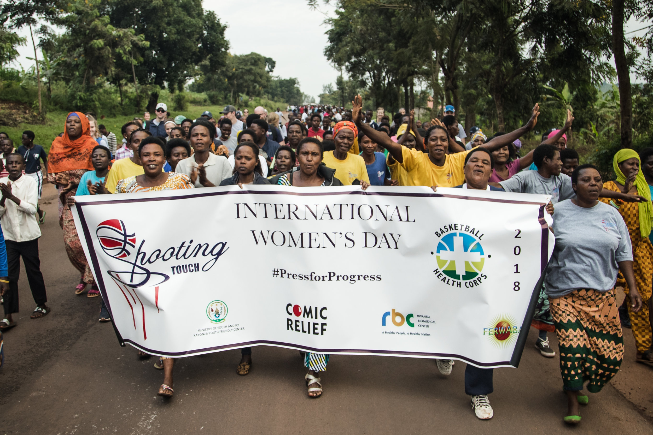 Over 1k people marched through the village of Nyamirama towards a basketball court to celebrate International Women's Day.