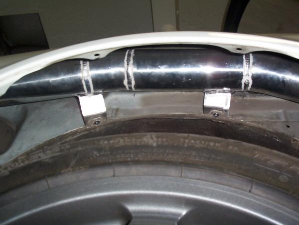 Boost pipe mounted inside rear fender