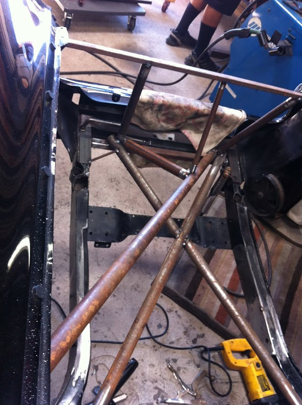 We decided to fabricate a new front clip, temporary bracing installed to hold important locations