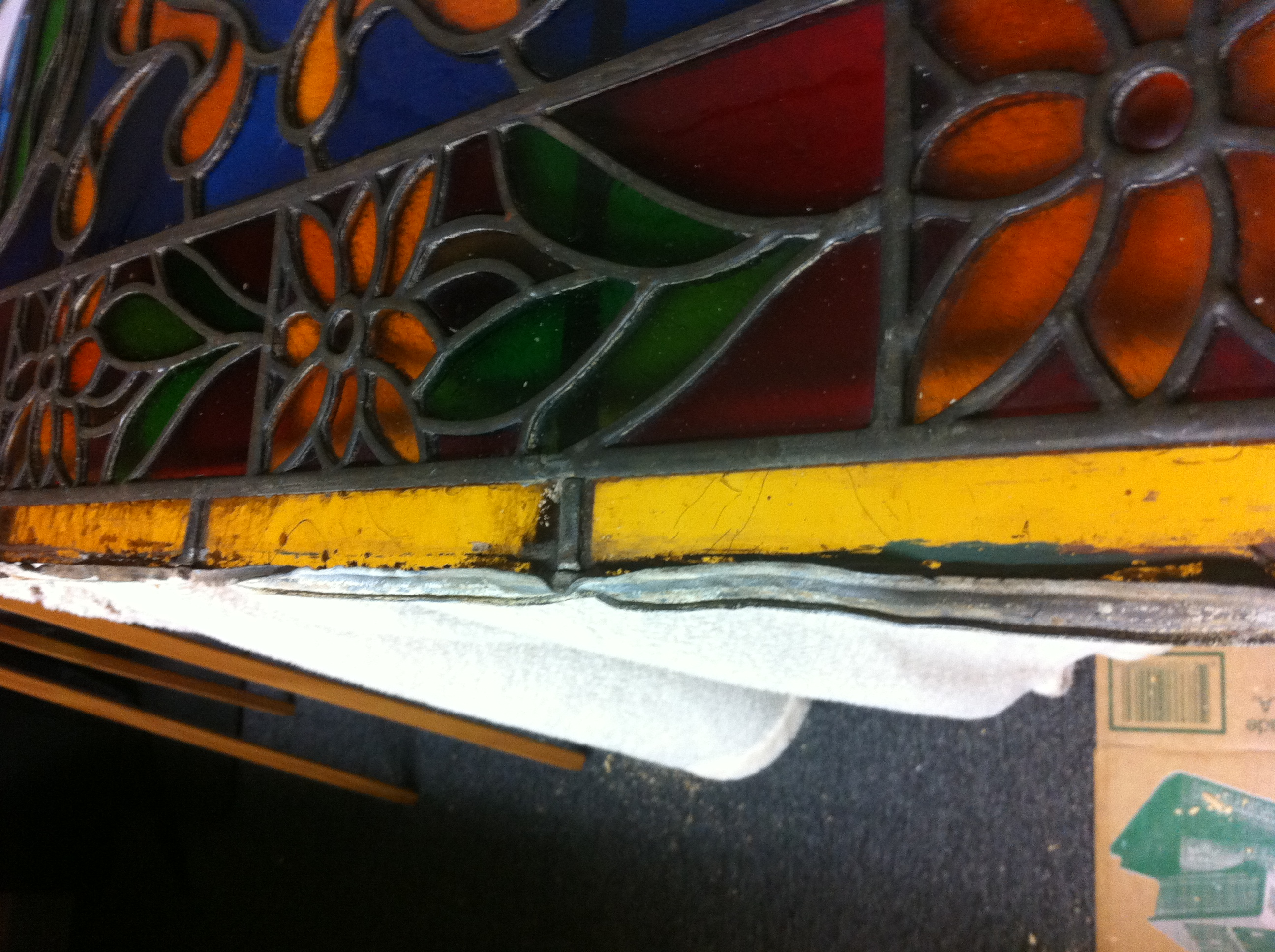 Late 1800's stained glass in need of a new frame..JPG