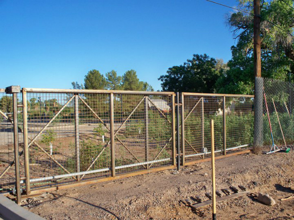 Artistic fence panels and gate.jpg