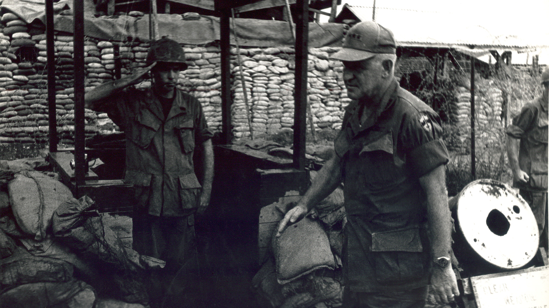 Sergeant Don Keller salutes General Abrahms during the siege of Dak To, 1969