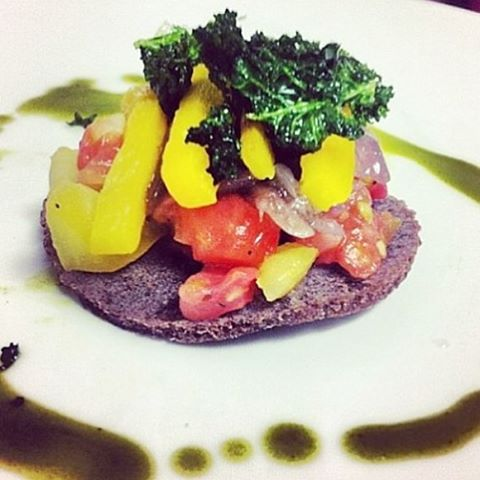 One of our favorites from the kitchen. Tin Tin Salad: heirloom tomatoes, roasted peppers, crisp kale and jalapeño vinegrette  over toasted injera. #ethiopianfood #ethiopiancuisine #injera #ethiopia #hornofafrica #cheflife #nomnom