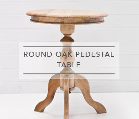 round-pedestal-oak-table