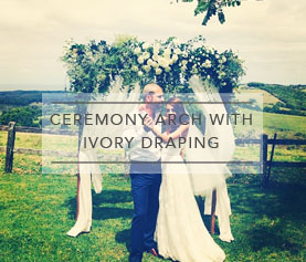 ceremony-arch-ivory-draping.jpg