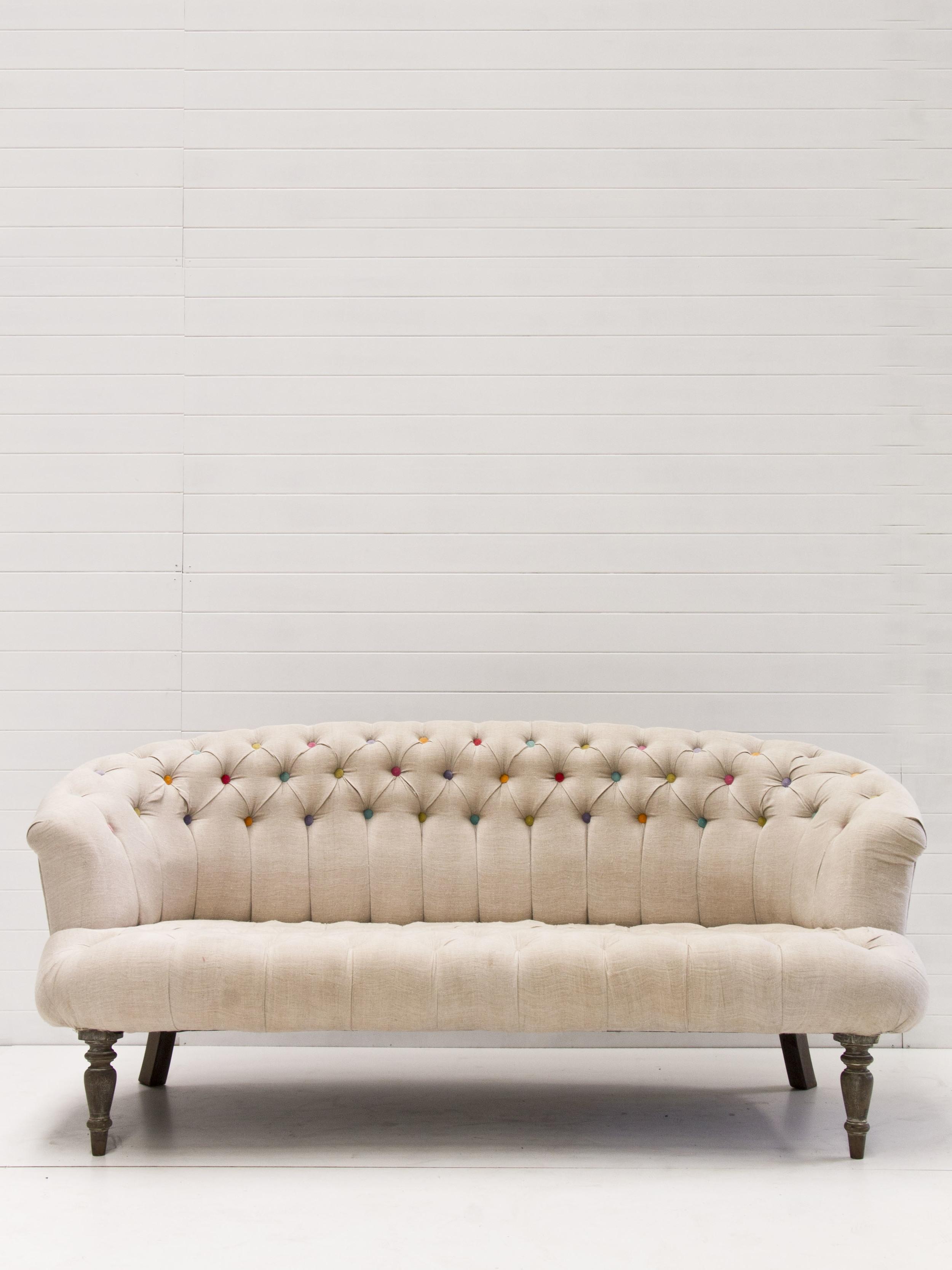 Coloured button tufted sofa.jpg
