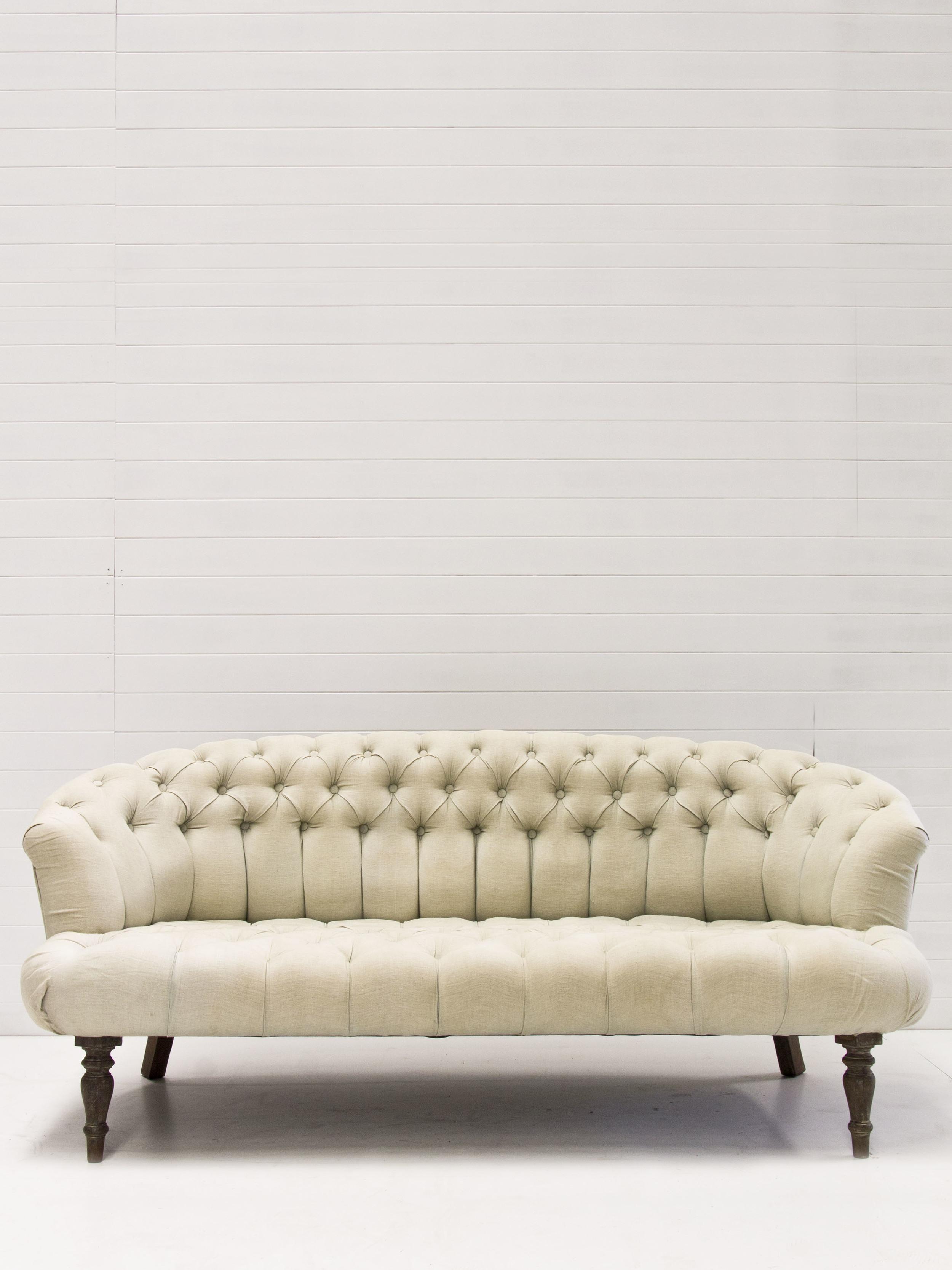 Seafoam button tufted sofa.jpg