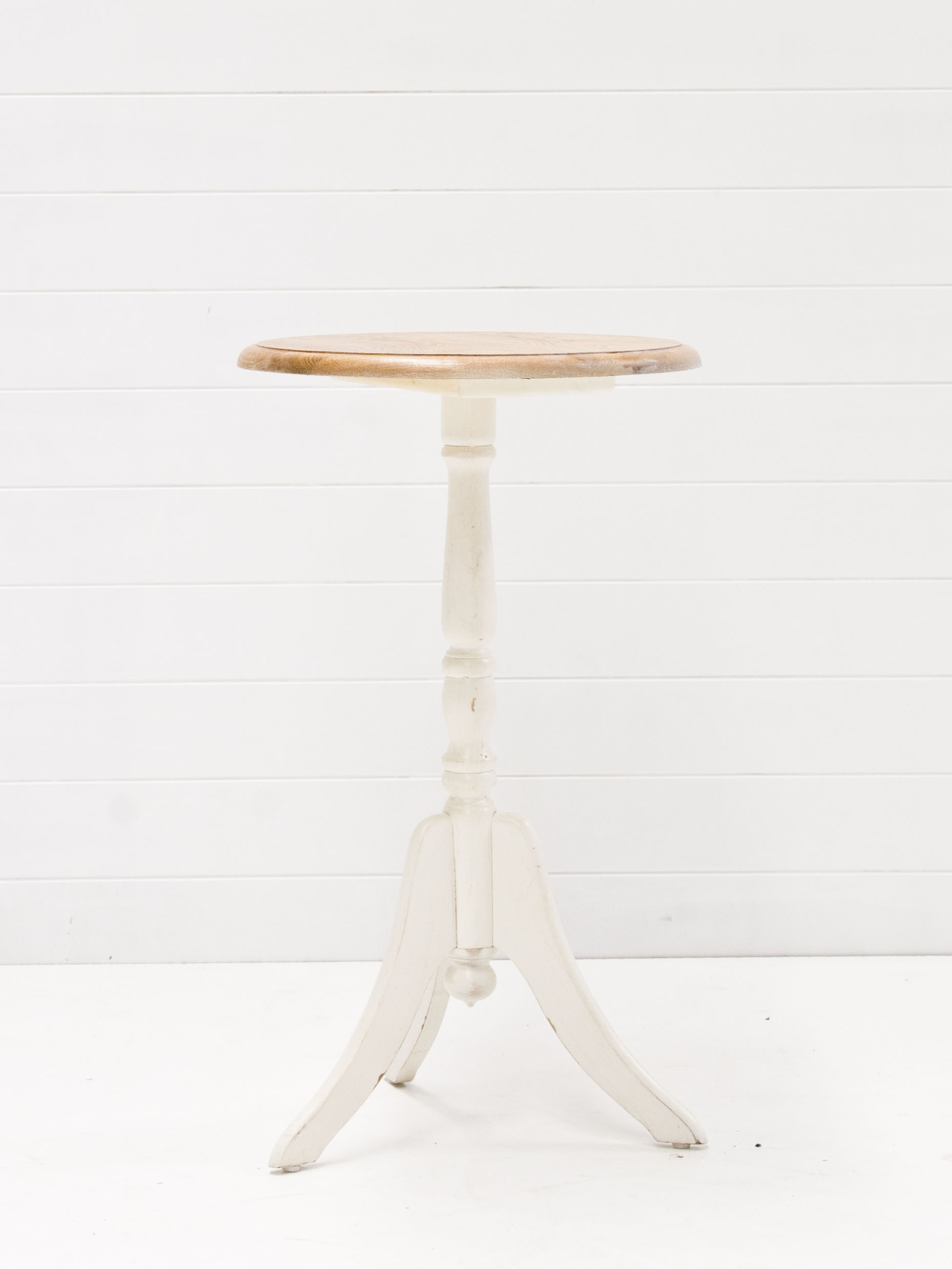Small round wooden table with white base.jpg