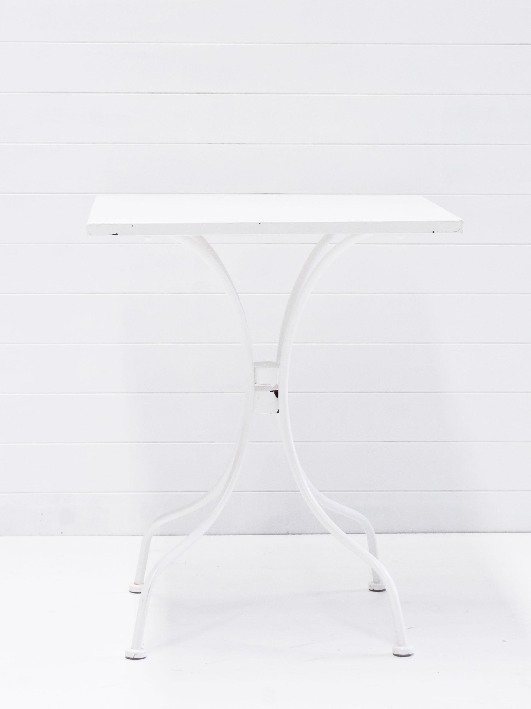White cafe tables.jpg