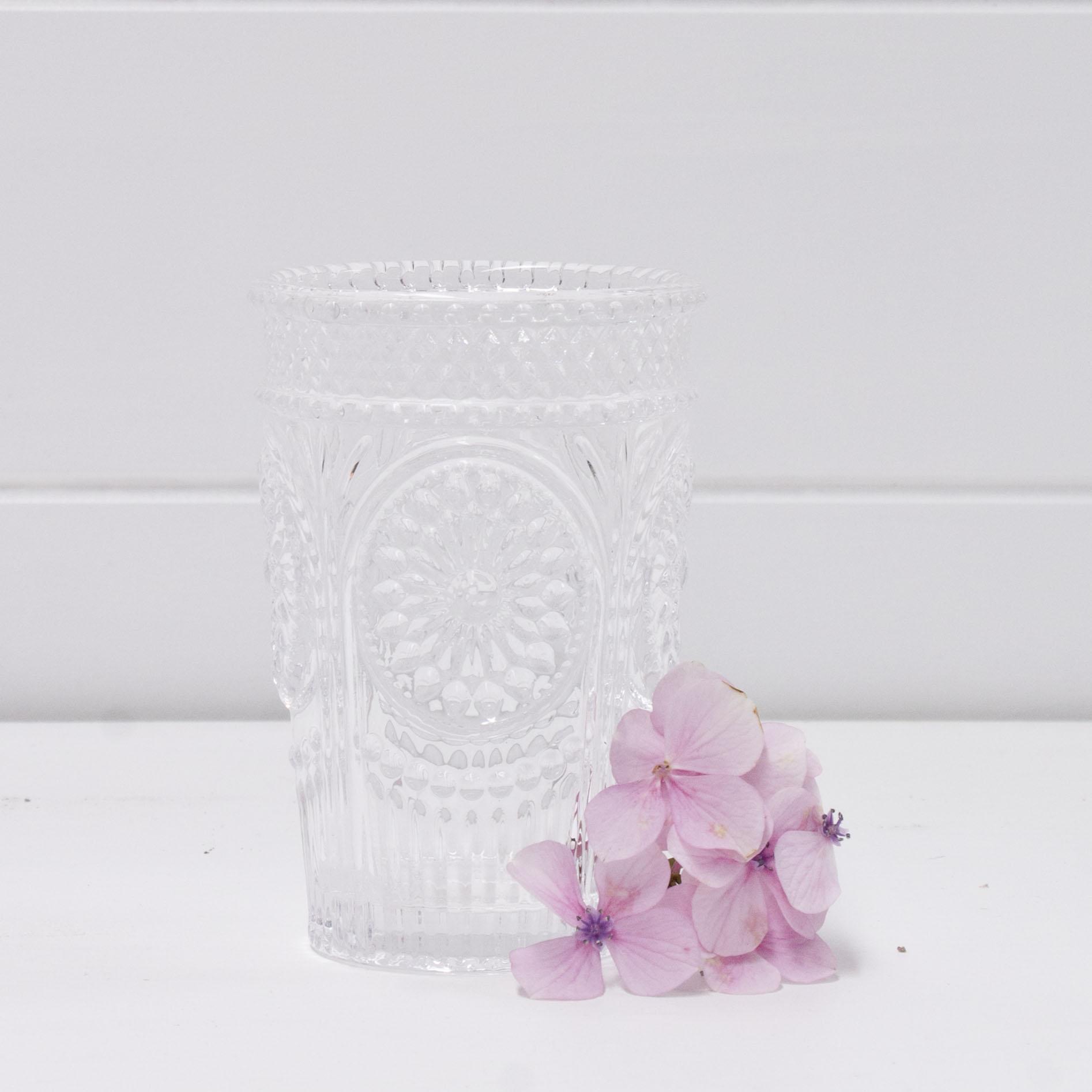 Ornate clear glass tea light holder.jpg