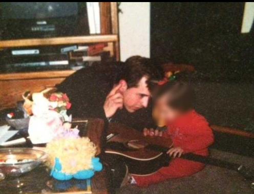 My brother was also a father. Here he is teaching his daughter to listen to the music.