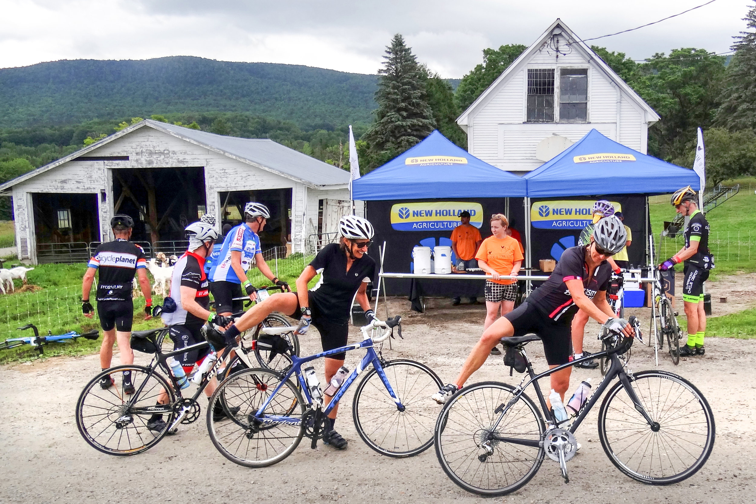 Farm to Fork Fondo - Vermont cyclists at a gourmet food stop on a local farm