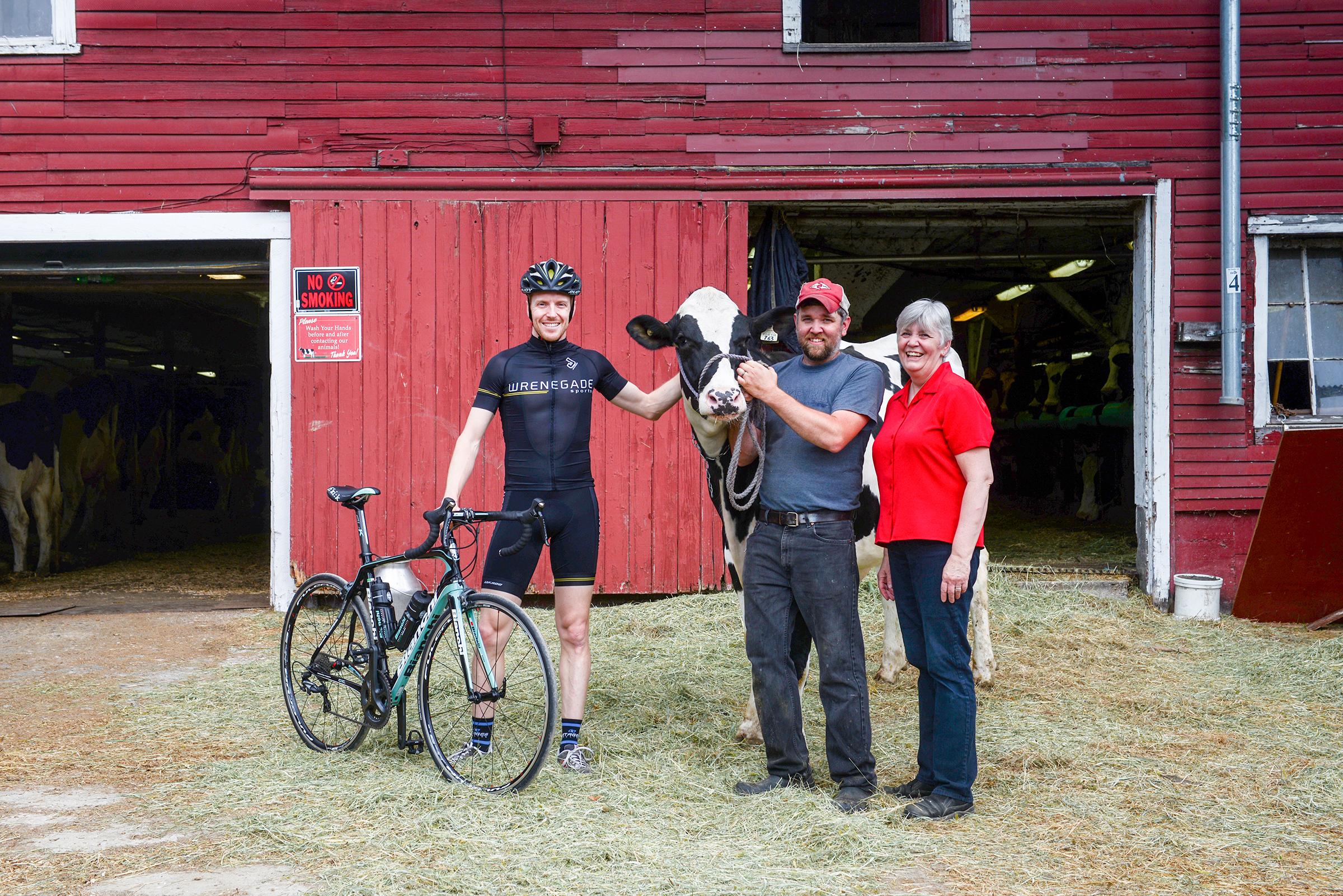 Farm to Fork Fondo series founder Tyler Wren with the Kennet Family of featured farm Liberty Hill Farm in Rochester, Vermont