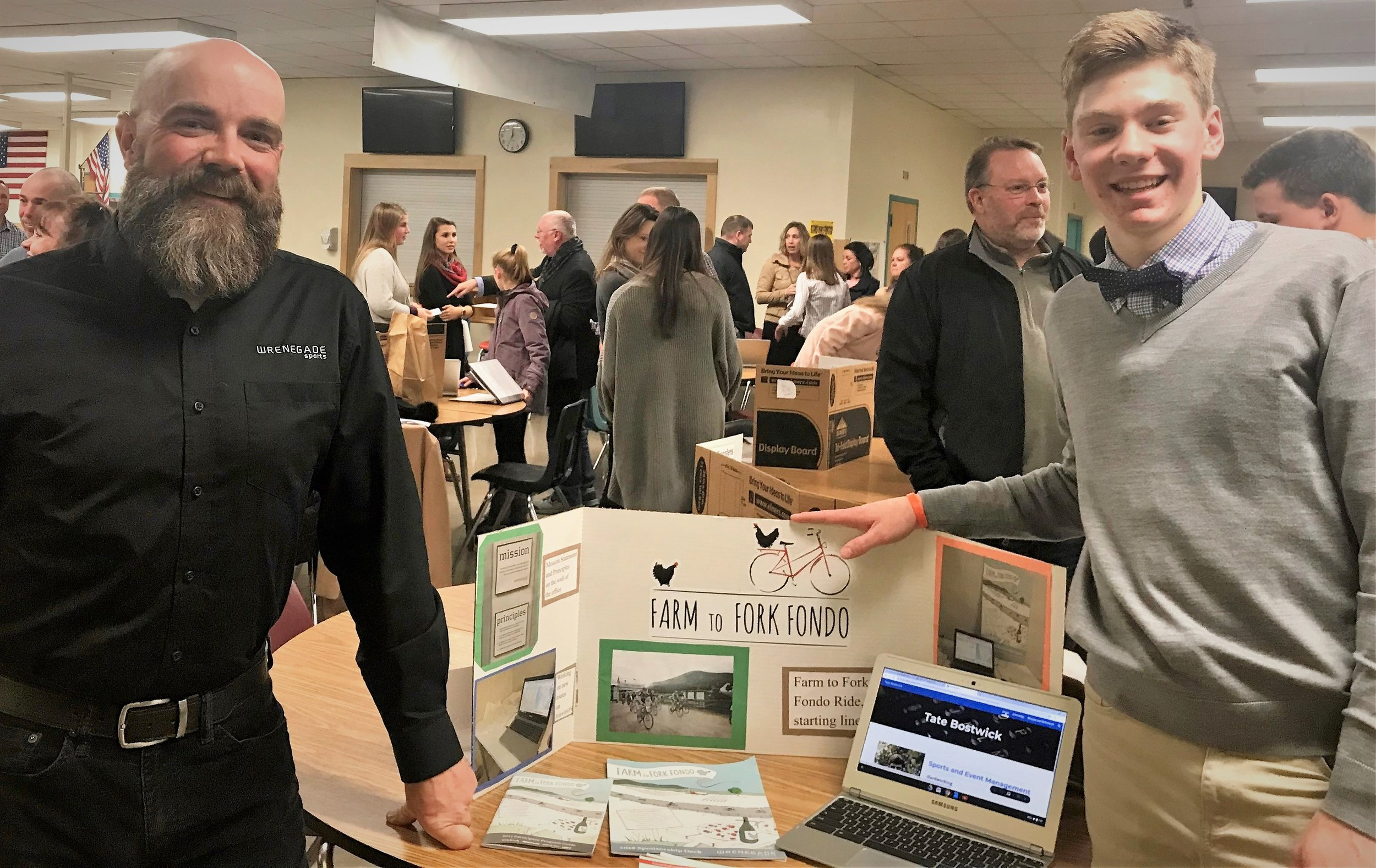 At Essex High School's Internship Exhibition Night: Jim Beebe-Woodard, Director of Operations at Wrenegade Sports and Tate Bostwick, Wrenegade Sports Intern