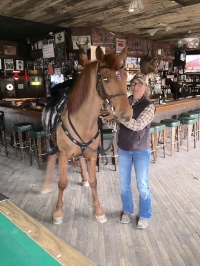 Cowgirl Kika and her horse Aragon in The RoundUp Saloon