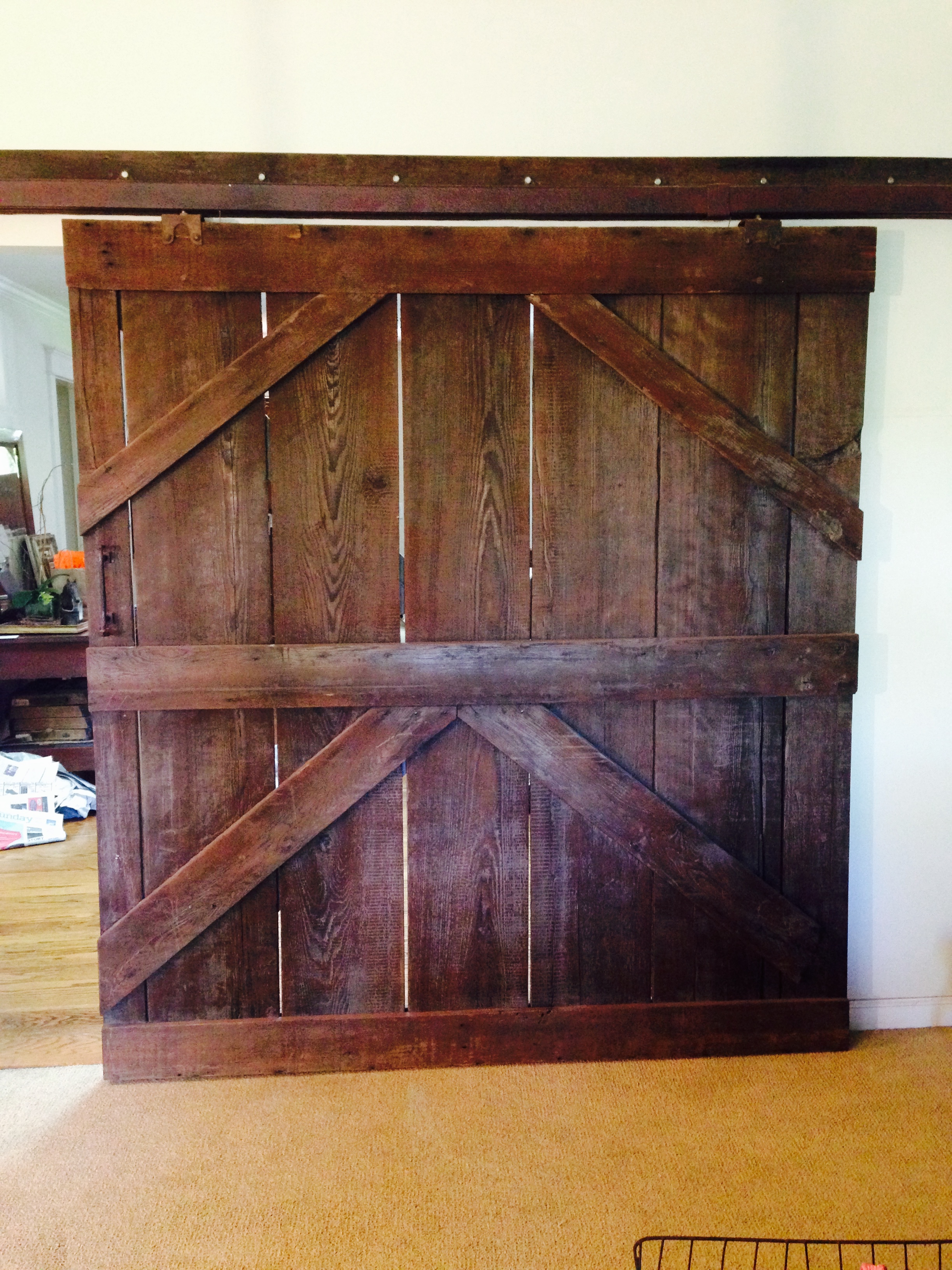 Salvaged barn door in a country-chic home.