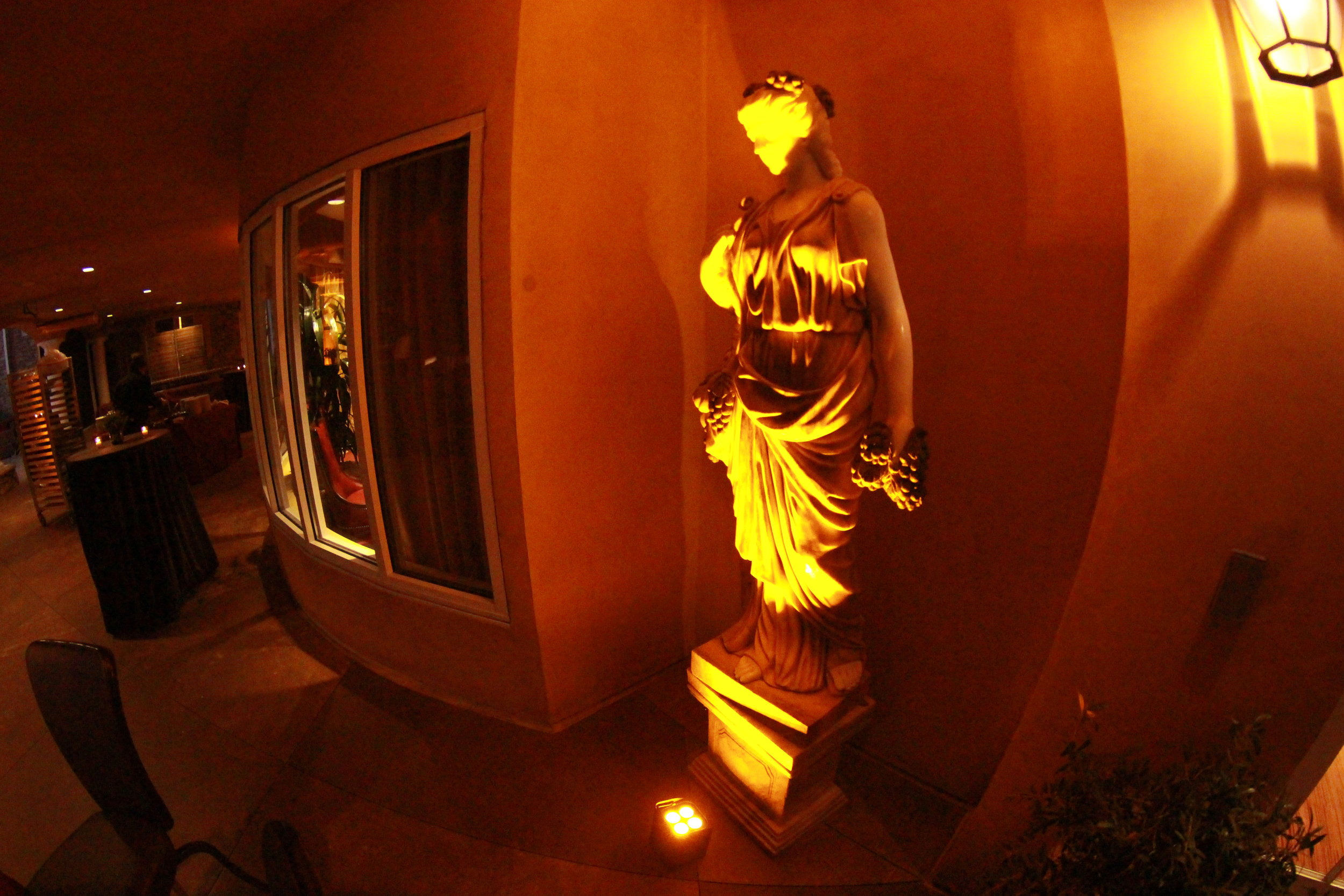Uplighting on a statue at an event at Meritage Resort and Spa