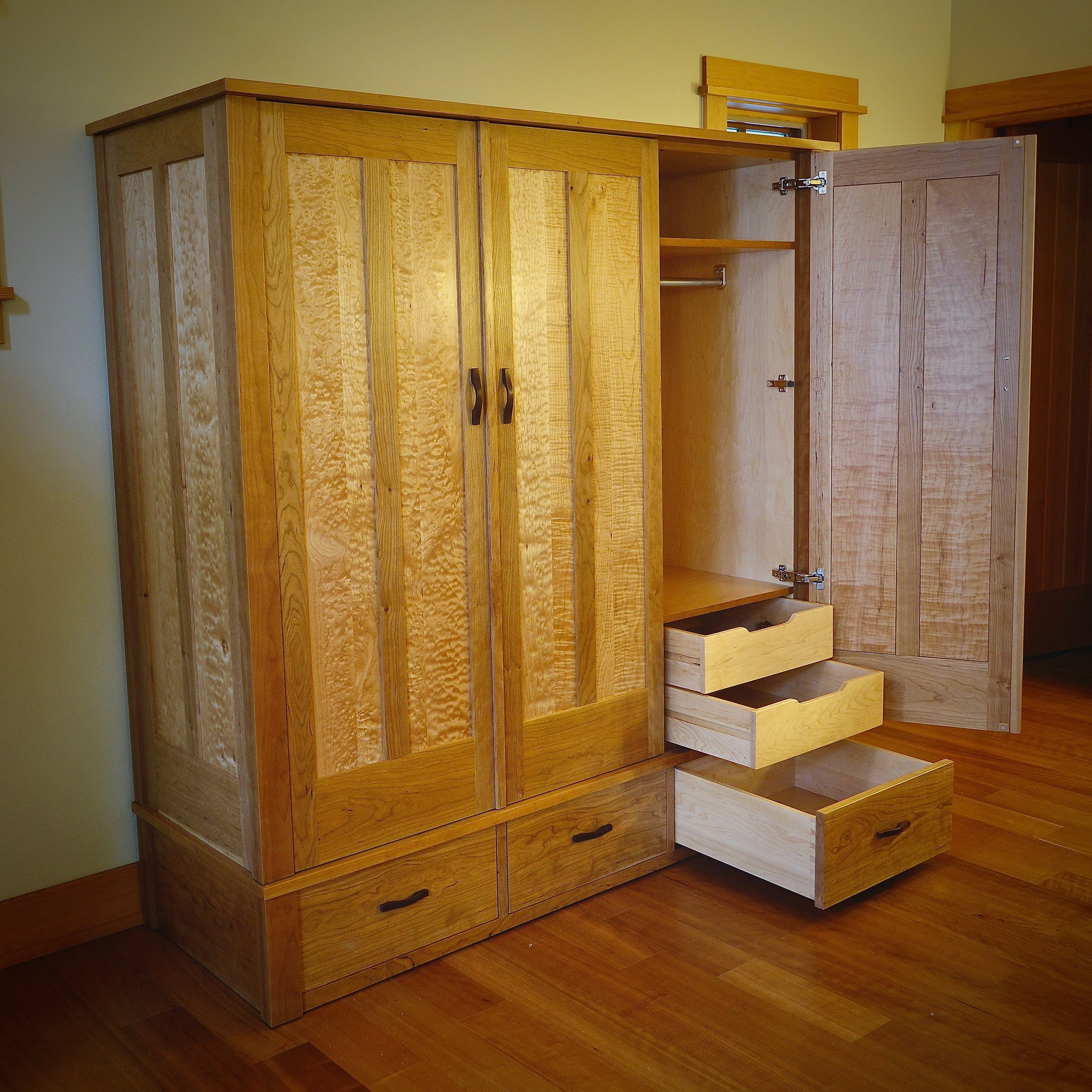 Cherry and quilted maple armoire delivered on Orcas Island.