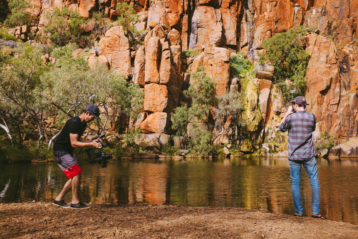 Darren McCagh (left) filming Jae Laffer with his film camera. Very trendy of you Jae...Waterhole- Pilbara, Western Australia