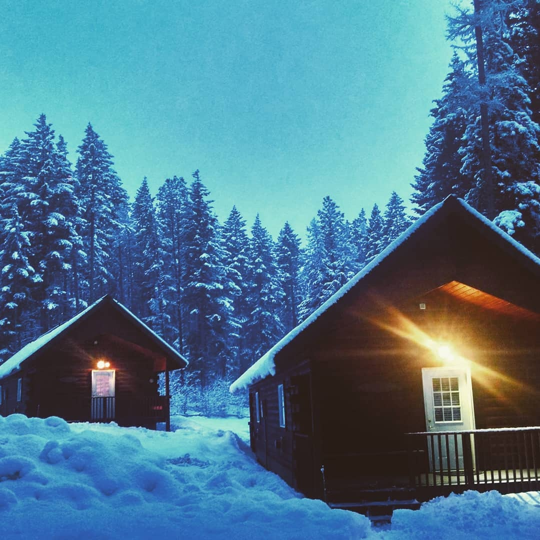 Two of our cabins nestled in fresh Cascade snow.