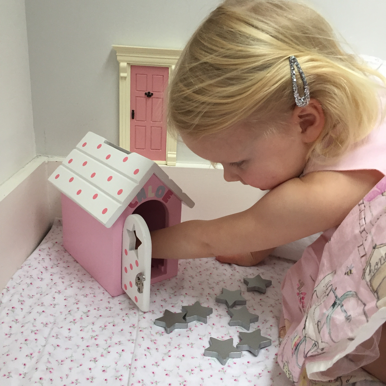 Little Girl opening The Fairy Reward Box.jpg