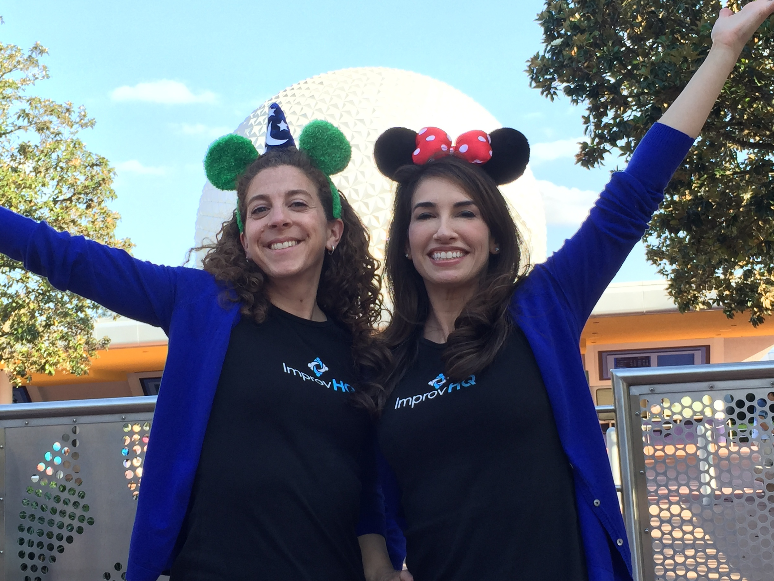 Betsy and Zoe from ImprovHQ posing in front of Epcot after a busy Day One.