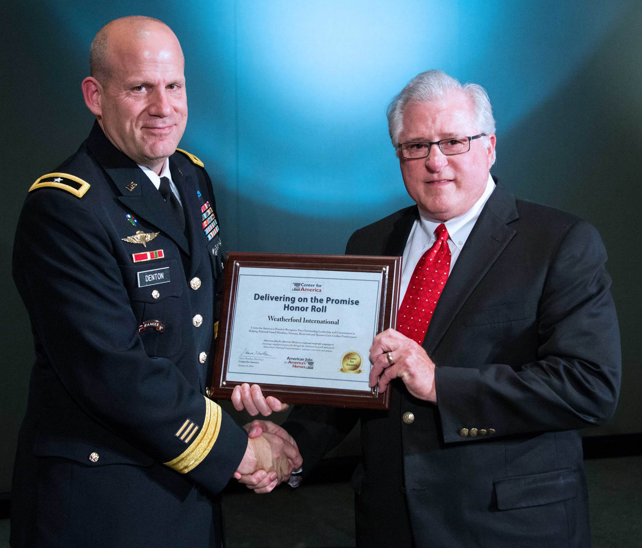 BG Ivan Denton presents the CFA Award to David Dyer, Human Resources Manager.