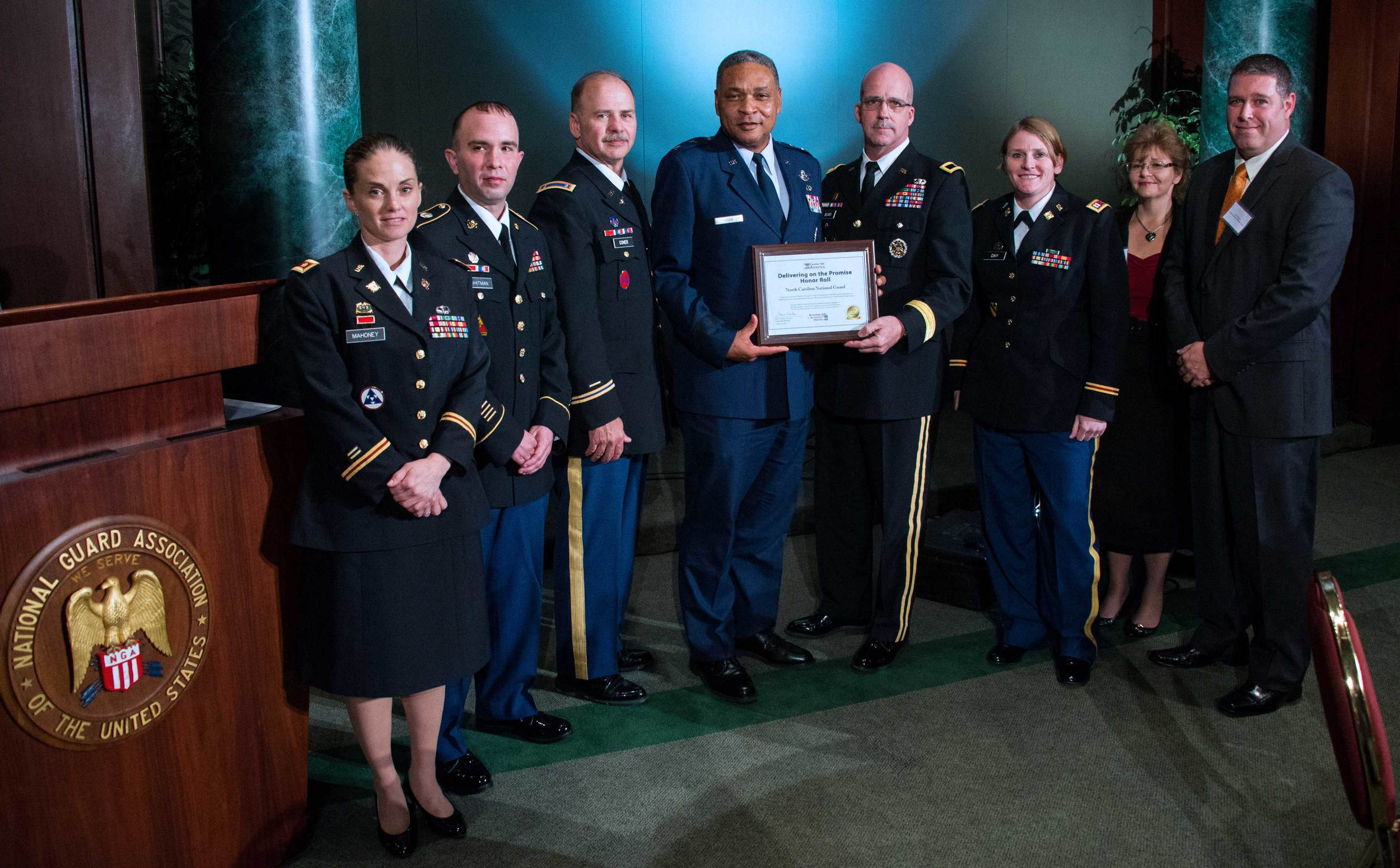 Major General Garry Dean presents the CFA Award to the Employment and Education Team, North Carolina National Guard