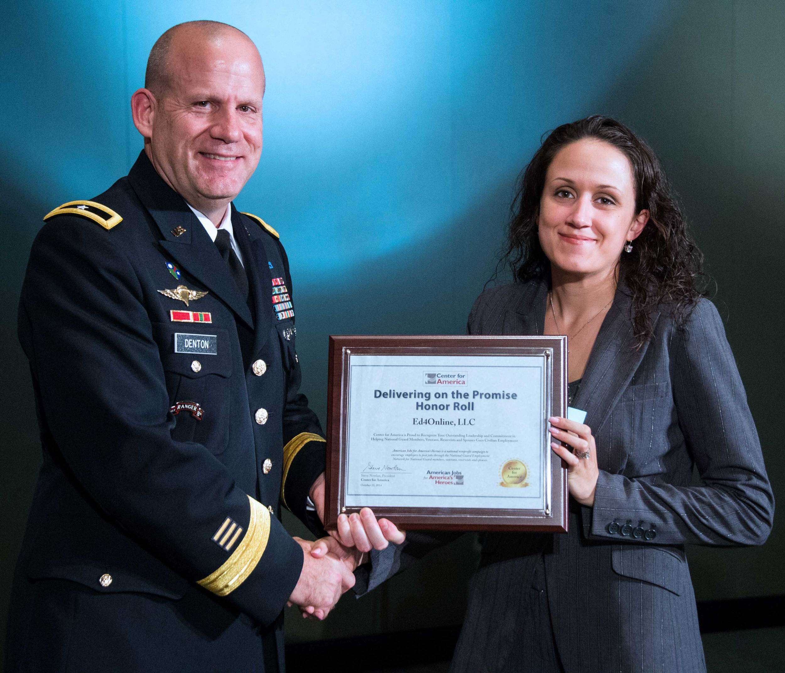 Brigadier General Ivan Denton presents the CFA Award to Angela Caban, Marketing Specialist, Ed4Online