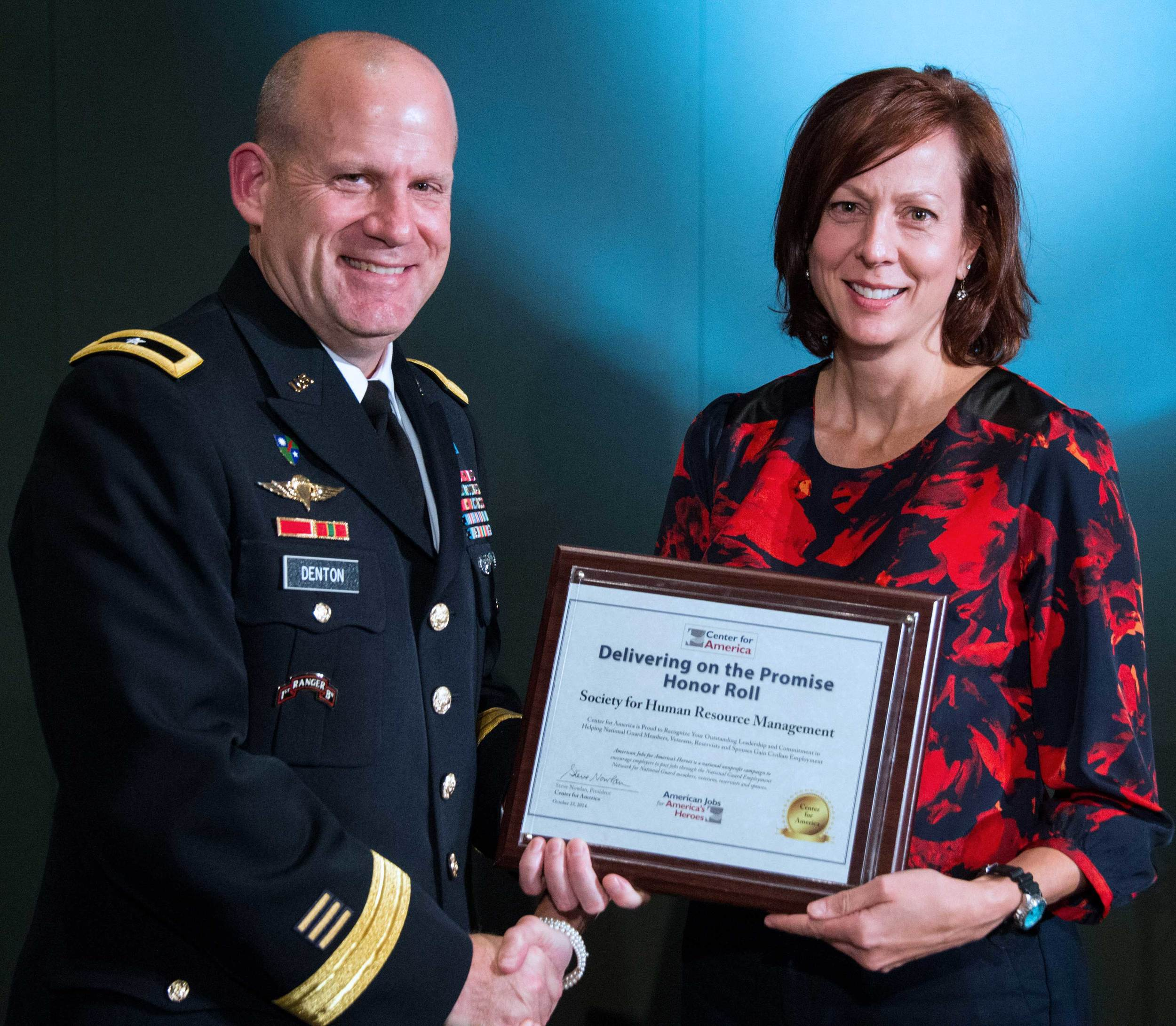 Brigadier General Ivan Denton presents the CFA Award to Nancy Hammer, Senior Government Affairs Policy Counsel, Society for Human Resource Management