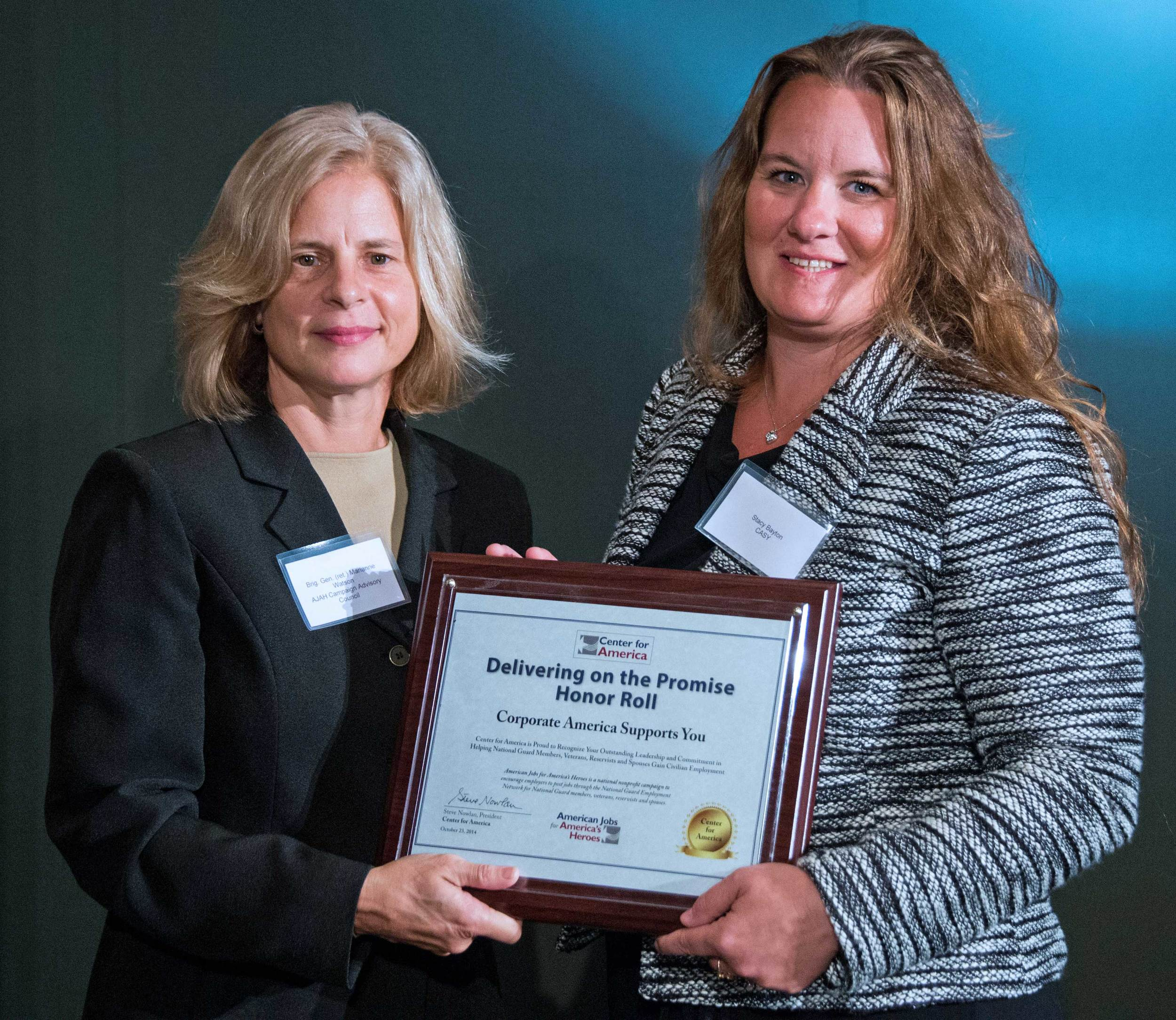Brigadier General (ret) Marianne Watson presents the CFA Award to Stacy Bayton, Chief Operating Officer, Corporate America Supports You (CASY)