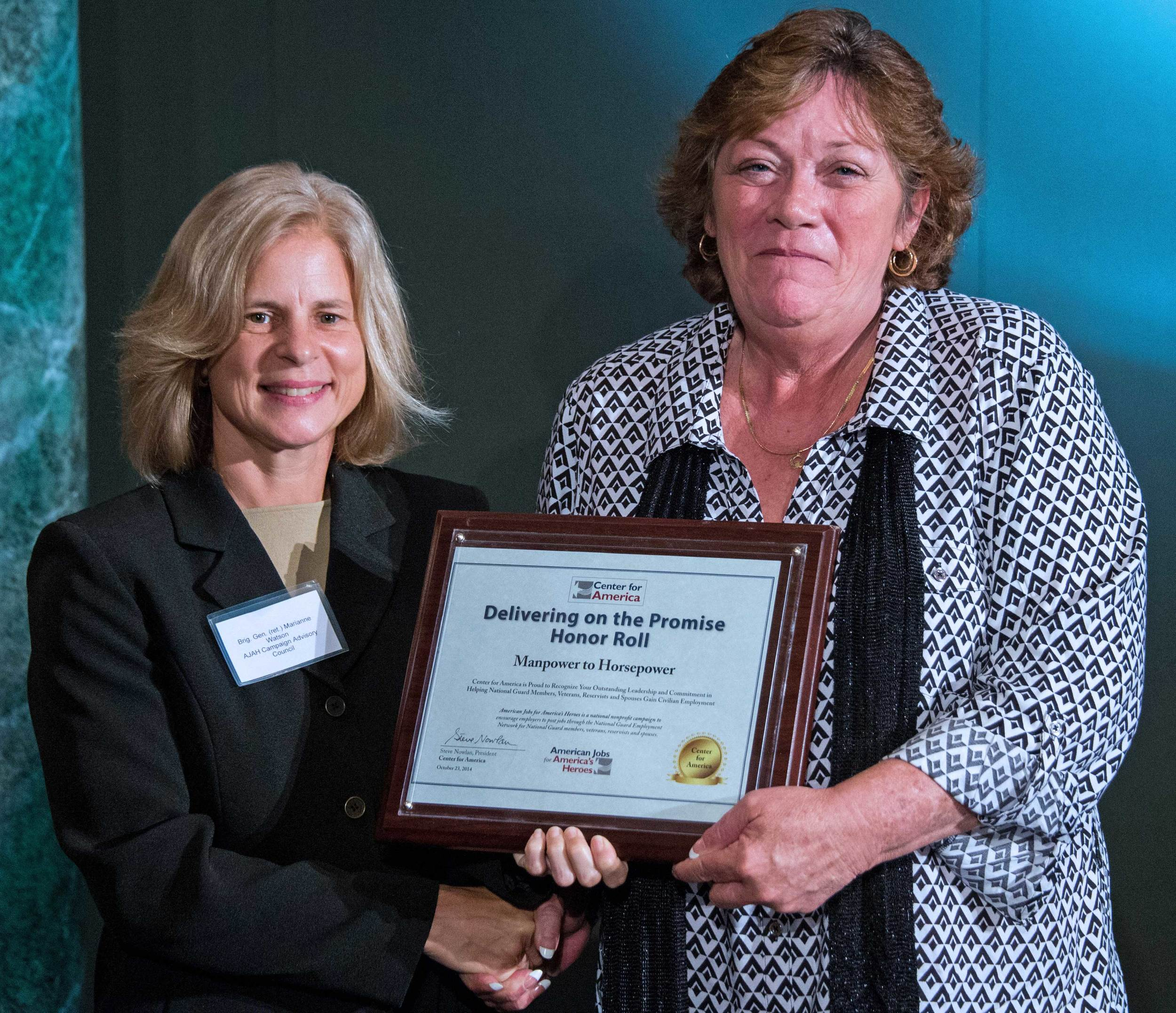 Brigadier General (ret) Marianne Watson presents the CFA Award to Sue Roberson, Founder and Director, Manpower to Horsepower