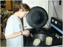 Student loading samples in centrifuge.