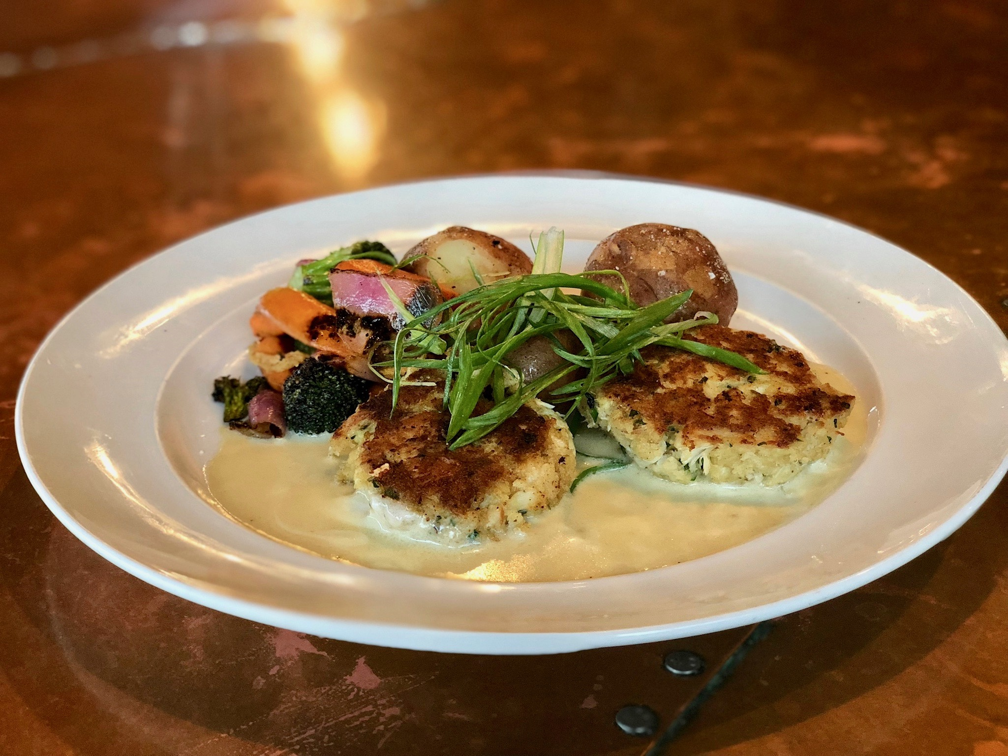 Crab cakes are part of the seasonal soft-shell crab menu thtis month at Burntwood Tavern in North Naples. (Photo: Burntwood Tavern)