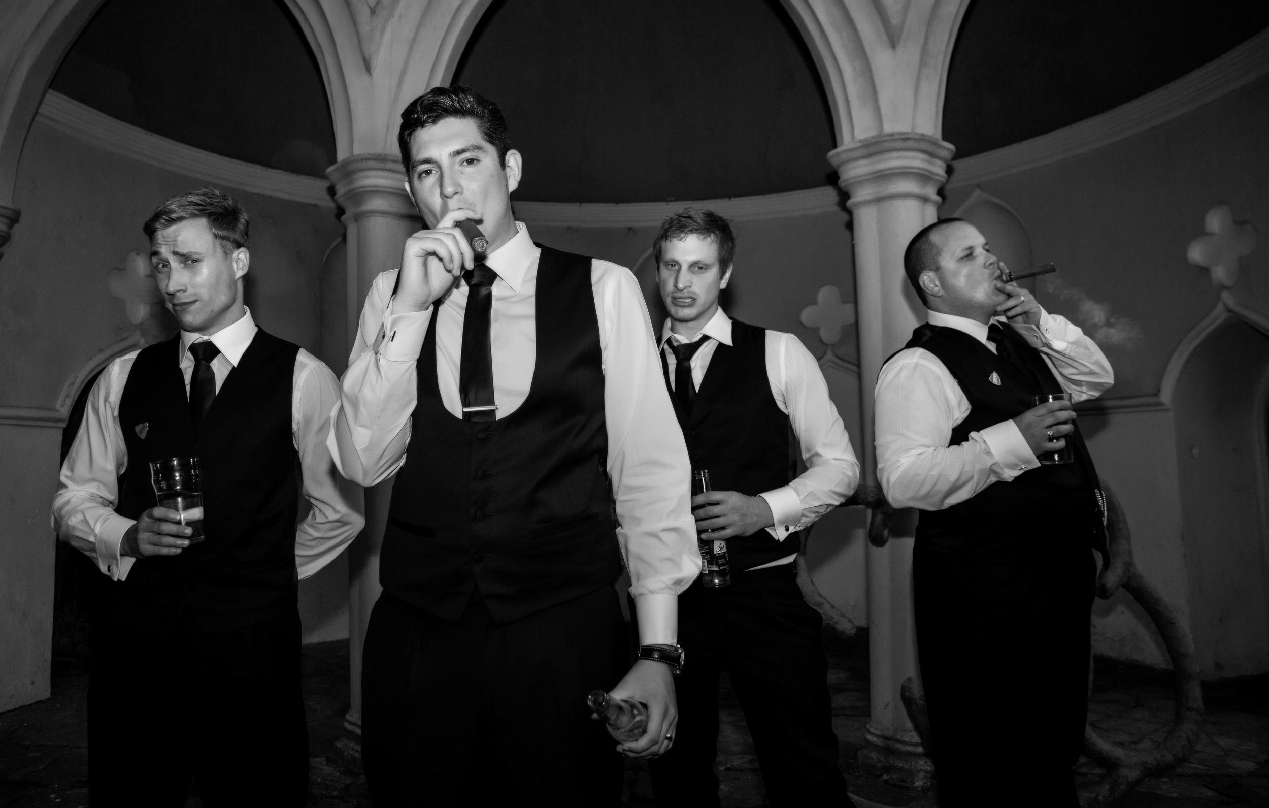 colchester-groomsmen-cigar-posing-london-uk-destination-wedding-photography-Adam-Rowley