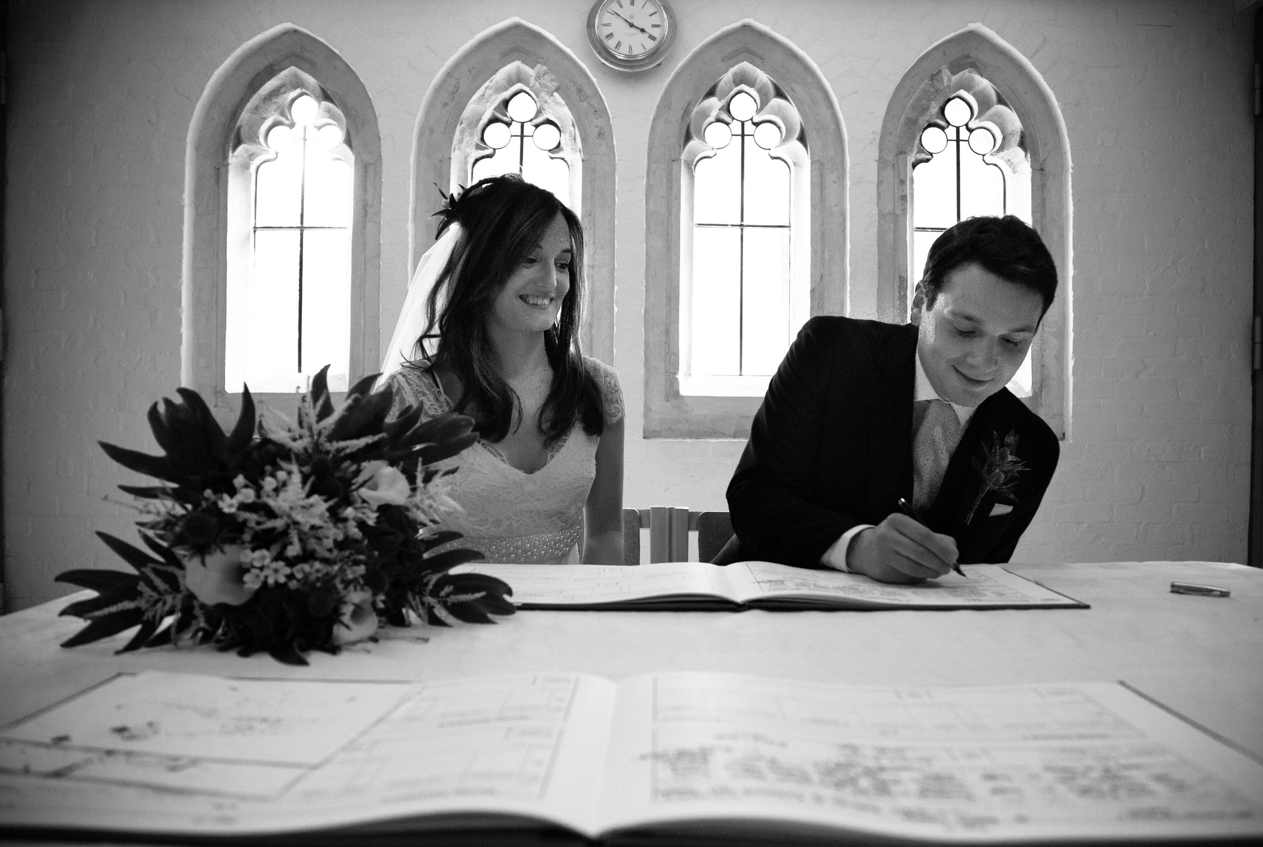 st-mary's-church-barnes-signing-register-london-uk-destination-wedding-photography-Adam-Rowley