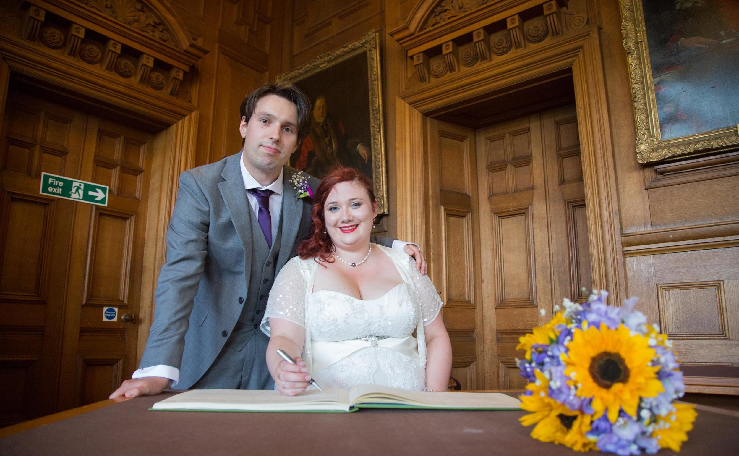 sign-the-register-eastbourne-london-uk-destination-wedding-photography-Adam-Rowley