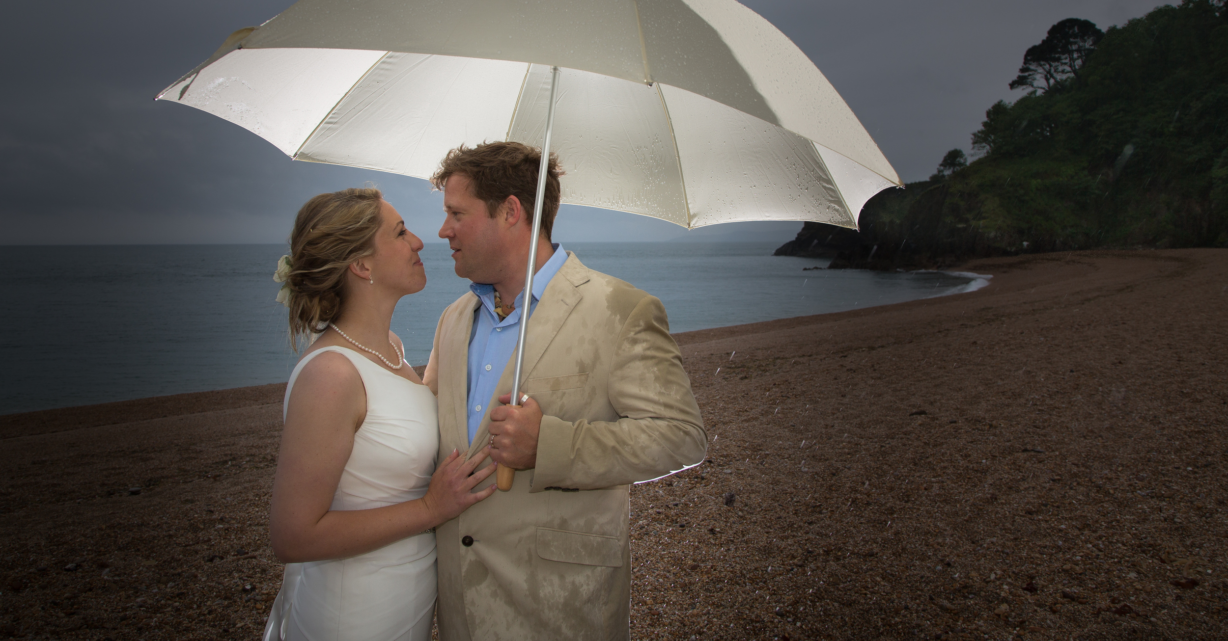 dartmouth wedding couple romance umbrella