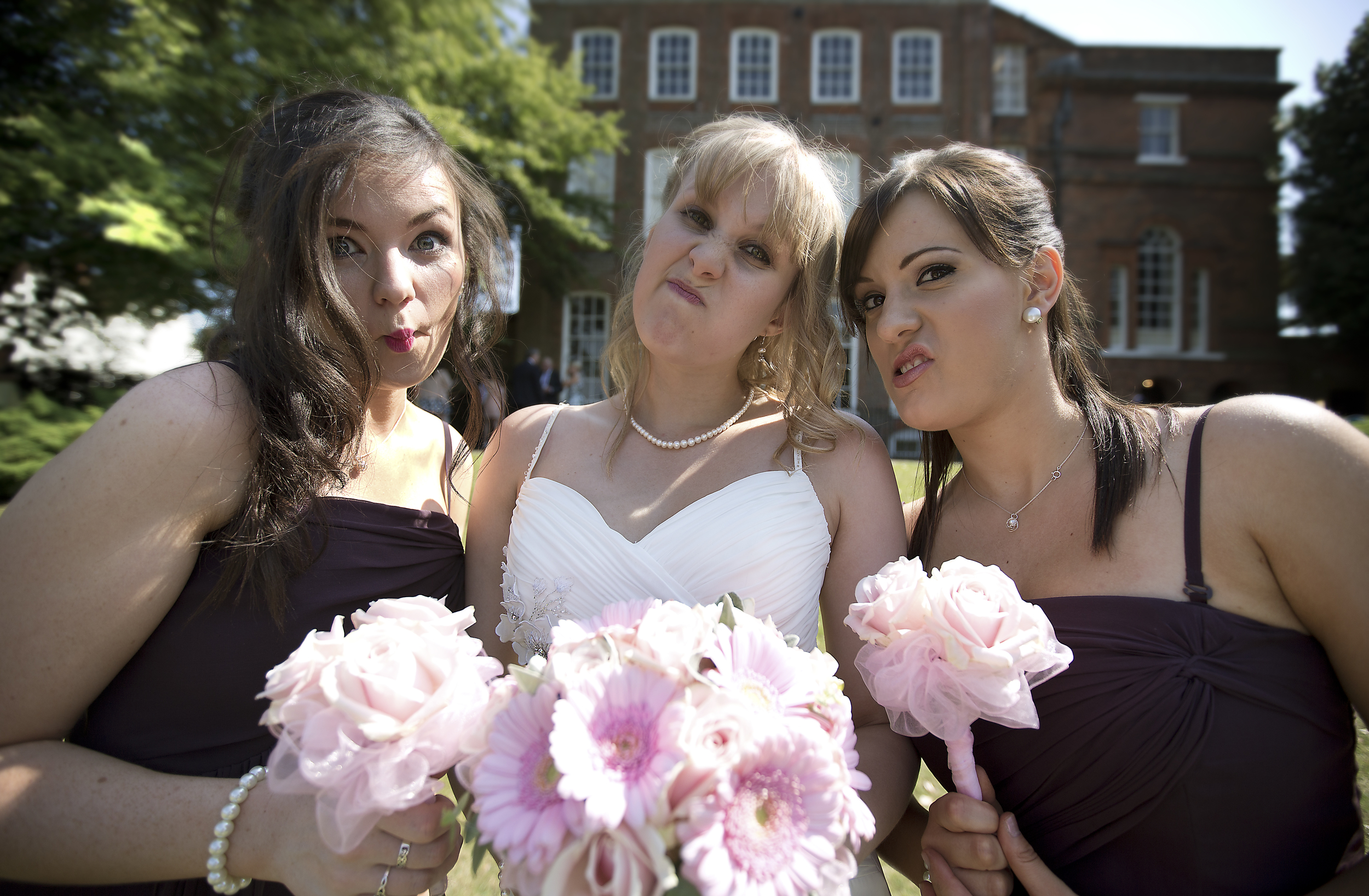 funny-group-formal-shot-wedding-colchester