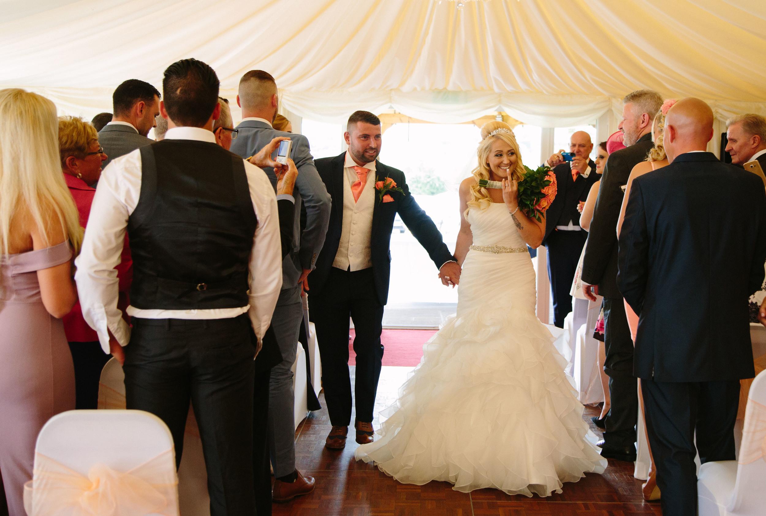 Essex-countryside-wedding-summer-down-the-aisl