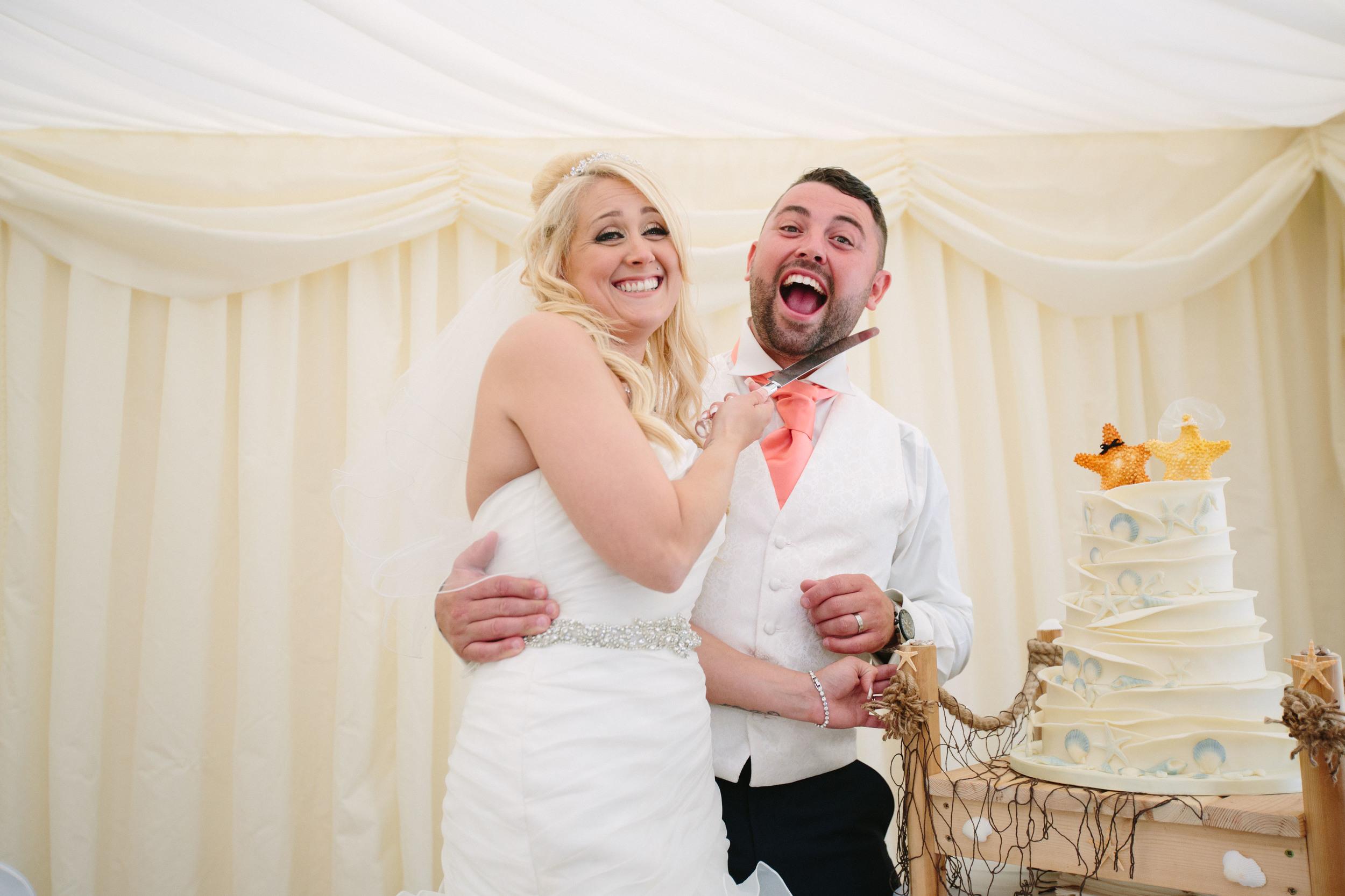 Essex-countryside-wedding-cake-cutting