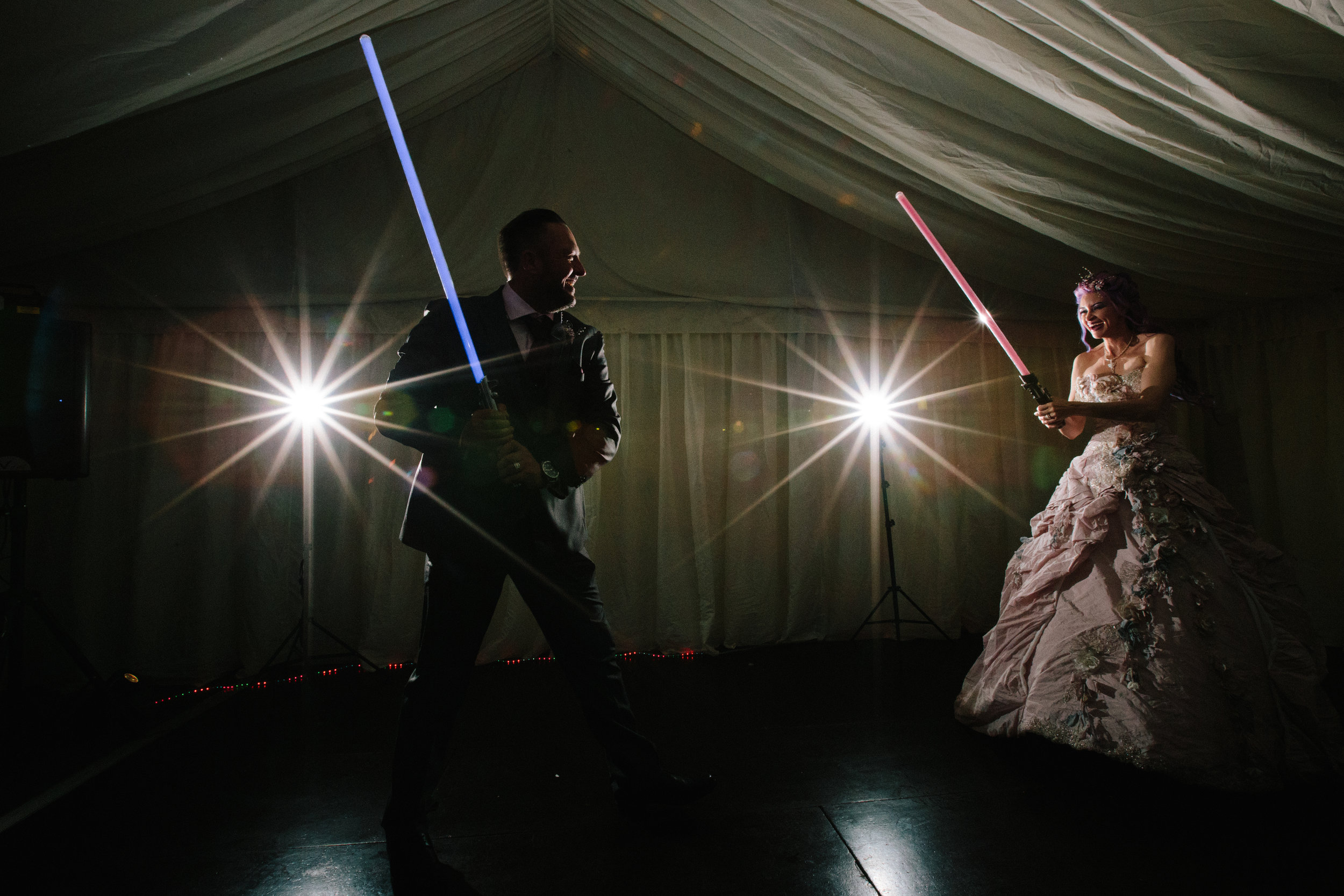 Hollwyood-characters-bride-essex-movie-theme-wedding-first-dance-light-sabre-1