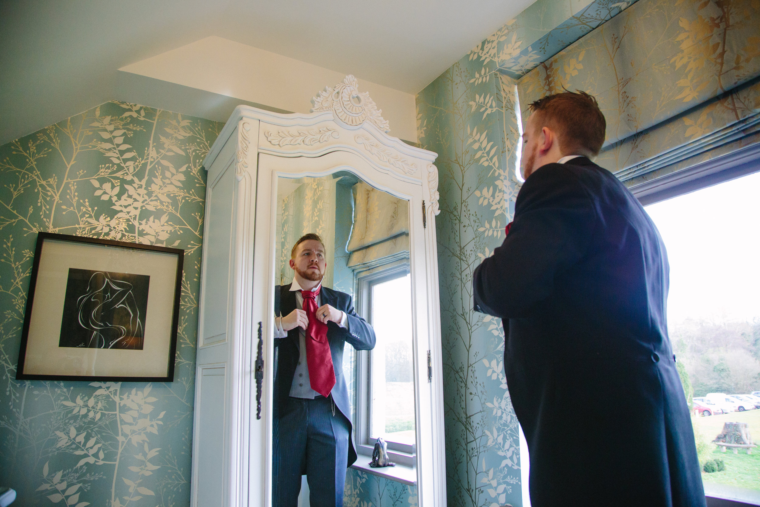Sussex-winter-wedding-photography-southdowns-manor-groom-prep-6