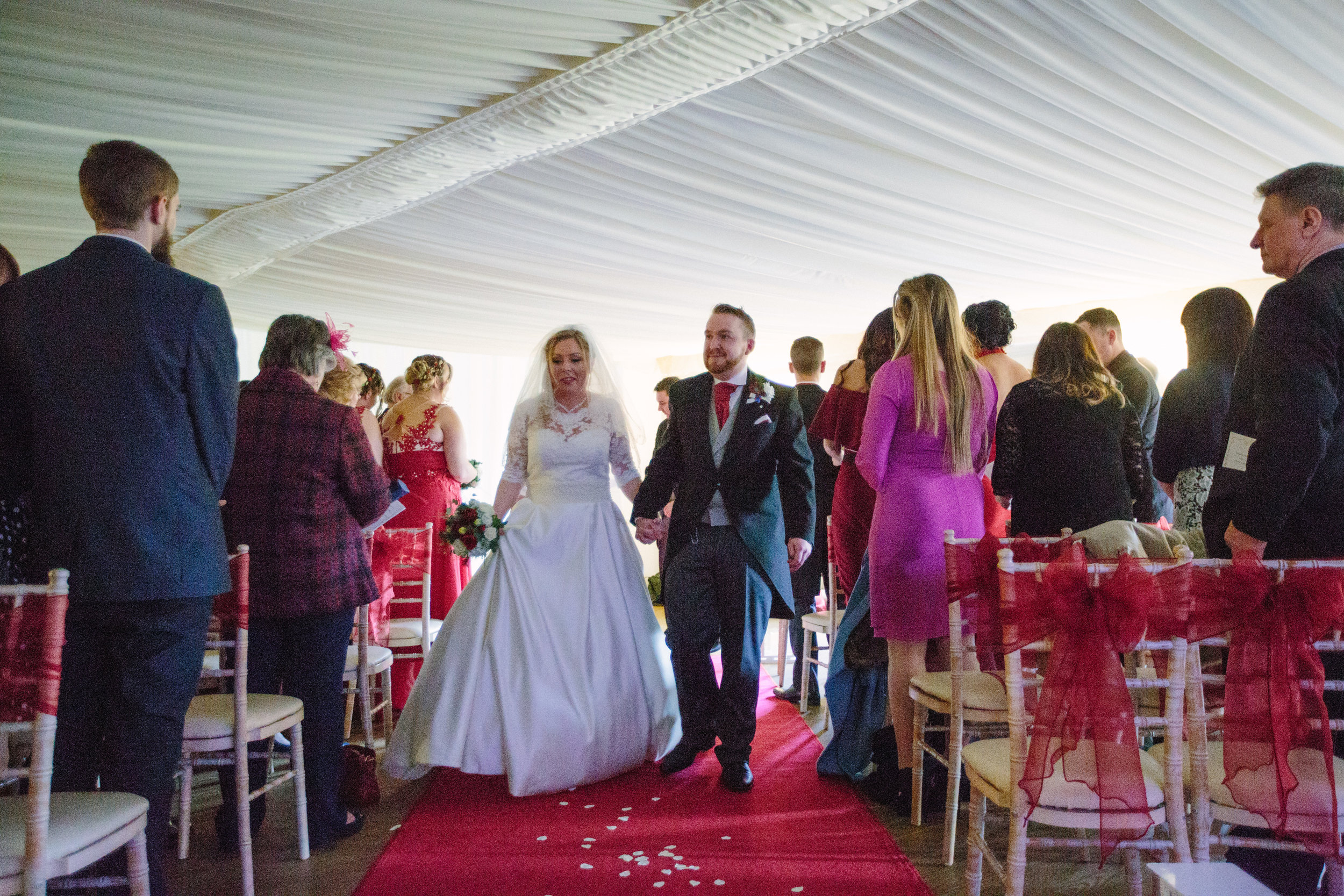 sussex-winter-wedding-southdowns-manor-photography-ceremony-aisle-43